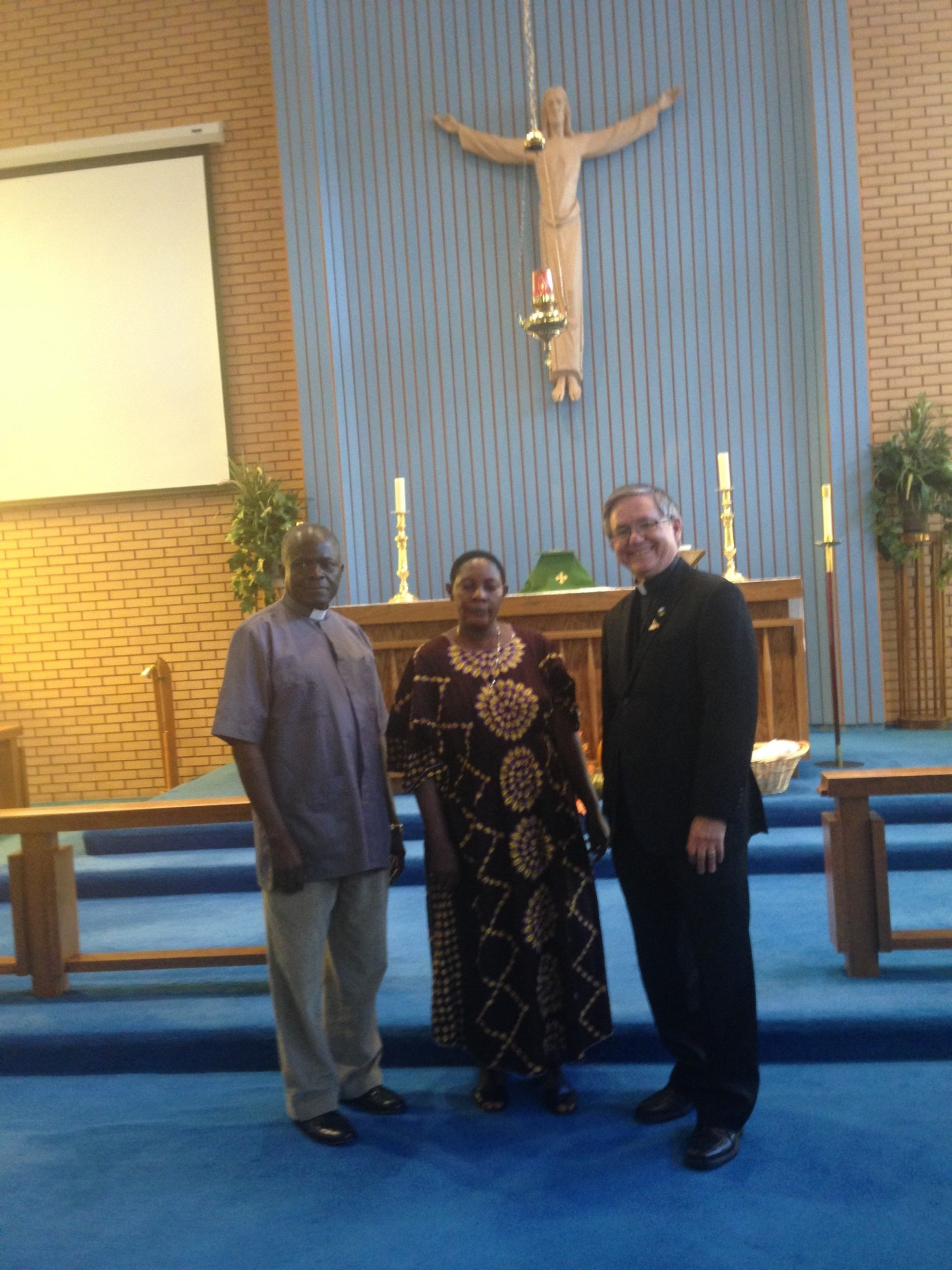 Archdeacon Jason Musoke, Central Buganda Diocese with wife, Faith and Pastor Murray